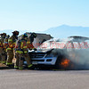 Falcon and Peterson AFB Firefighters opening the hood on a fully involved vehicle fire on Meadowbrook Parkway. November 23, 2016