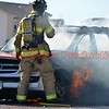 Firefighters work to extinguish a well involved vehicle fire on Meadowbrook Parkway in Falcon, Colorado. November 23, 2016