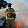 A fire officer on the scene of a well involved vehicle fire in Falcon, Colorado. November 23, 2016