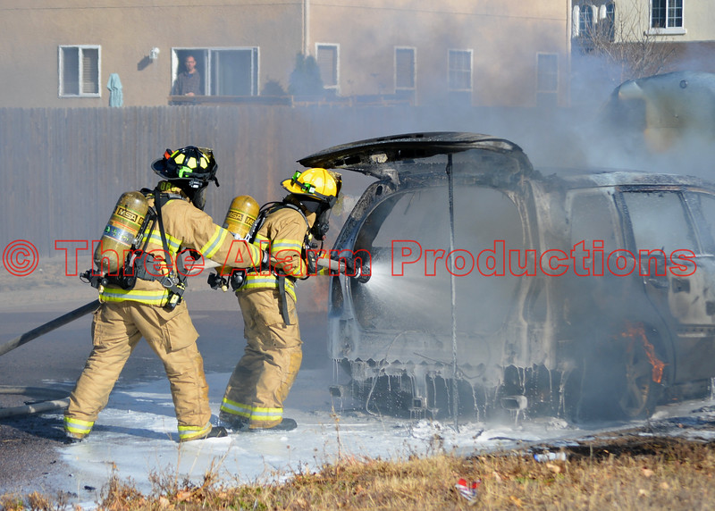 Peterson Air Force Base Firefighters with PAFB Fire Engine 21, apply foam to a heavily burning suv fire in Falcon, Colorado. November 23, 2016