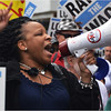 Exhorting marchers: SEIU, Local 1199, Executive Vice President Veronica Turner-Biggs.