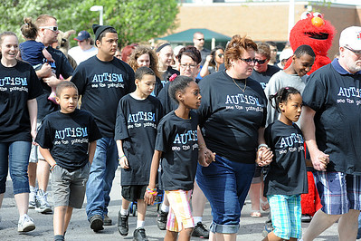 "Participants take off in the third annual ""Walking With Autism,"" a one-mile autism walk to help pay for therapeutic playground equipment for the Spectrum Resource Center and School in Lorain at LCCC on May 4.  There were 500 walkers in the fundraiser.  Construction will  start in July.   Steve Manheim"