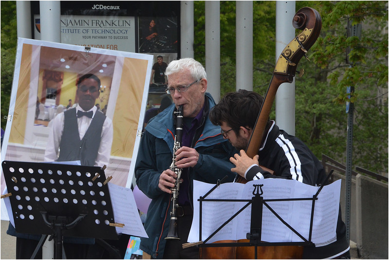 Members of the Me2/ orchestra based in Boston, Bob Crabtree (left) and David Cordes perform on Malcolm X Boulevard as part of the Musical Memorial project.