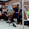 Musical Memorial ensemble near Madison Park Technical Vocational High School on Malcolm X Boulevard (left to right): Joshua Addison, Rebecca Strauss, Javier Caballero and Ashleigh Gordon.