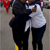 Clementina Chéry (left) and Isabel Gonçalves greet each other as the walk starts off along Geneva Avenue.