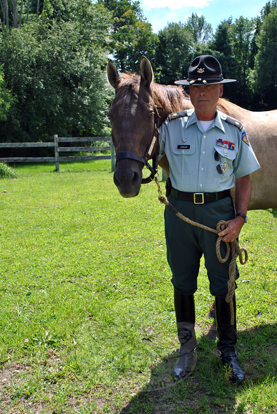 Major Gordon J. Johnson, commandant of the Second Company Governor's Horse Guard, poses with Morgan, one of ten geldings that make up the stable of the Second Company Governor's Horse Guard.(Crevier photo)