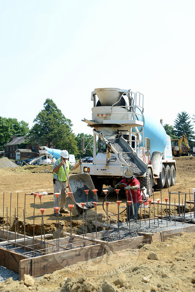 Crews from Sega Ready-Mix Concrete, Co. of New Milford fill footings Tuesday, August 20, for a new ambulance garage at Fairfield Hills. (Bobowick photo)