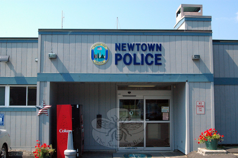 A new sign positioned above the front door at the police station at 3 Main Street includes a greatly enlarged image of the shoulder patch that town police wear on their uniform. Installation of the new signage follows the town's recent refurbishment of the building's exterior. (Gorosko photo)