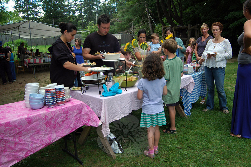 Family members and Housatonic Valley Waldorf School summer campers line up for the camp's culminating harvest feast on Friday, August 16. (Hallabeck photo)