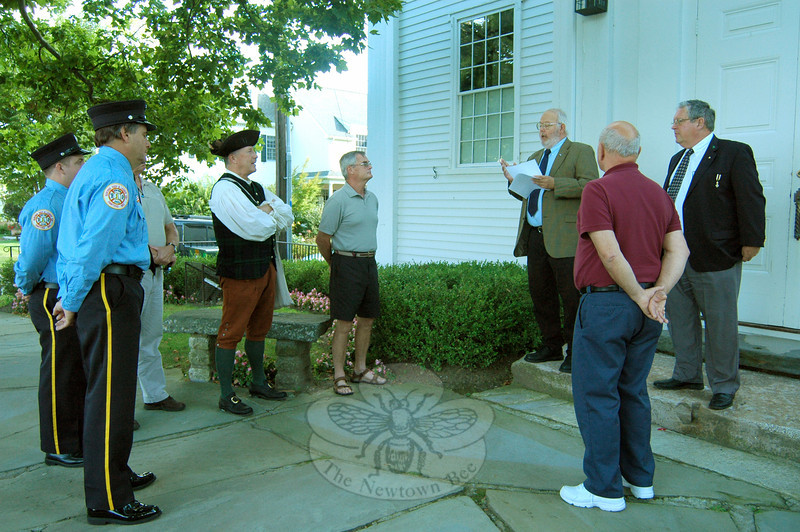 Dave Shugarts, third from right, representing the Sons of the American Revolution, Connecticut Society, Reverend Ebenezer Baldwin Branch, read an announcement to honor Newtown's Flag Keeper David Lydem and representatives of Newtown Hook & Ladder Co. No. 1, the Newtown Lions Club, and Newtown Hardware for their service to the town's flagpole. (Hallabeck photo)
