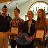 From left are Newtown VFW Post 308 Senior Vice Commander Brendan Dlouhy, Mark Todd, First Selectman Pat Llodra, and Kate Rebman at a ceremony Monday, August 19, at VFW Post 308 to award Mark and Kate scholarships. (Hallabeck photo)