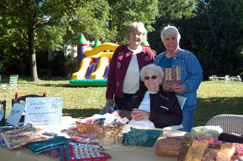 Silvia Krug, left, Terry Curry, center seated, and Aida Reiske gathered together at a stand during the community tag sale to benefit Hawleyville Volunteer Fire & Rescue Company last weekend. (Hallabeck photo)