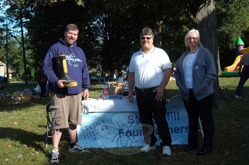 From left is Sandy Hook Four Corners (SH4C) Association President Keith Watson, Hawleyville Volunteer Fire & Rescue Company Chief John Basso, and SH4C member Terry Laslo, on Sunday, September 15, during a community tag sale held to benefit the Hawleyville Volunteer Fire & Rescue Company. (Hallabeck photo)