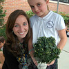 St Rose of Lima School student Ryann Heim and St Rose of Lima second grade teacher Erin Yost helped Ms Yost's class plant mums at the school on Friday, September 13, to replace flowers planted by Ryan in honor of the 26 victims at Sandy Hook School on 12/14. (Hallabeck photo)