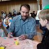 Andy Hathaway, center, worked to create Ben's Bells with his children Faith, left, and Will during Newtown High School Kindness Club's Day of Kindness. (Hallabeck photo)