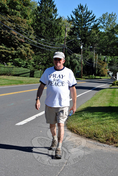 "Al Forte walks down Route 302, Wednesday, September 18. Mr Forte passed through Newtown en route from Boston to New York City, spreading a message to ""Pray For Peace."" (Crevier photo)"