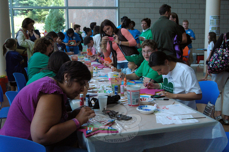 People worked on decorating Stars of Hope at a table set up for the Newtown High School Kindness Club's Day of Kindness, held on Saturday, September 14. (Hallabeck photo)