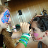 Newtown High School freshman Monique Dubois, left, painted NHS freshman Emma Sheridan's face during the September 14 event. (Hallabeck photo)