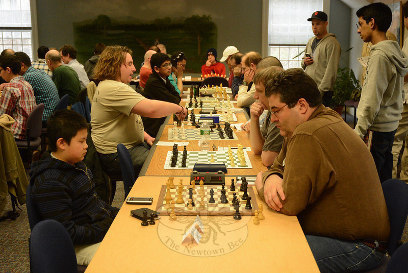 Thirty-five chess players competed in the 2014 Connecticut State Chess Championship held on Saturday, March 29, at C.H. Booth Library. Chess players of different ages and varying skill levels took part in timed chess matches at parallel tables in the library's meeting room.  National Master Gary Shure of Westport won the Championship section. (Gorosko photo)