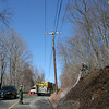 Botsford Fire Rescue was dispatched to Toddy Hill Road, in the area of Button Shop Road, around 2 pm Sunday, April 6, on a report of a brush fire in that area. Firefighters found a fire near the intersection, as reported, but were also alerted to a second brush fire on Toddy Hill Road, approximately 1,100 feet to the north of the original fire. Botsford Captain Patrick Keough, behind the engine, and First Assistant Chief Andrew White, on the hill, took care of the second fire. The cause of Sunday's fires is unknown, said Botsford Chief Wayne Ciaccia, who pointed out there have been a number of brush fires in town in recent weeks. (Hicks photo)
