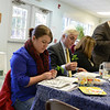 The local clergy leaders led an interfaith Seder at attended by a few dozen people at Newtown United Methodist Church on April 6. NCC Associate Pastor Alyssa DeWolf, left, sits beside Baha'i members John and Margo Woodall, while Rabbi Shaul Praver of Adath Israel, standing, recites from the Haggadah. (Bobowick photo)