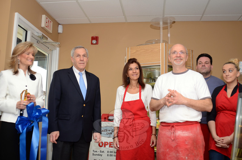 Longtime Newtown bakery owner Tony Posca celebrated the grand opening of his new shop Bakes n' Cakes at 316 Main Street South in Southbury April 2 along with Greater Waterbury Chamber Membership Director Cathy Dalton, Southbury First Selectman Ed Edelson, and staff including Josephine Mirafiore, Addio Watt and Emily Paolian. (Voket photo)
