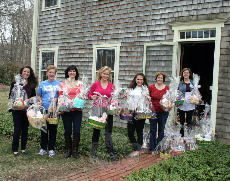 Women Involved in Newtown (WIN) members were joined by friends and family this year for the club's annual Easter Baskets workshop. This is the 16th year the local club has made sure that holiday baskets are filled with candy, dolls, and other items, and then delivered to a number of area locations, ensuring that Easter Sunday will be happier for dozens of children. On Friday, April 11, a work session was held at the home of WIN member Mandy Monaco. WIN President Colette Ercole reported 250 baskets were filled this year, with WIN providing $500 worth of candy and additional donations of baskets, grass, candy and dolls provided by The Chase School. Once filled, the baskets were delivered by members to Newtown Social Services and St Rose Church; AIDS Interfaith Ministry and Healing Hearts Center, both located in Danbury; and three new locations being helped by the club this year: Salvation Army of Greater Waterbury and St Vincent DePaul Mission, also in Waterbury; and Safe Haven of Southbury. Filled baskets filled many hallways of the Monaco home, and were even spilling out the front door while waiting for delivery last week. Among those participating Friday morning were, from left, Cyndy DaSailva, Alice Baye, Colette Ercole, Laurie Antous, Brittney Antous, Wendy Delehanty, and Morgan Maisto. (Hicks photo)
