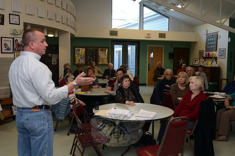 Board of Finance Chairman John Kortze, left, speaks to about three dozen residents who gathered April 16 at the Newtown Senior Center to get an update on a senior tax relief ordinance ahead of a planned Public Hearing May 7. He was joined by Legislative Council members Ryan Knapp, who chairs the ordinance committee, and Robert Merola, as well as Board of Education Secretary Kathryn Hamilton. (Voket photo)