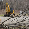 An excavator stands in a parking lot at 30-32 Church Hill Road after some tree and brush clearing work was done nearby. The site is being prepared for the construction of a multiple-building, two-level retail/office complex known as The Villages at Lexington Gardens. (Gorosko photo)