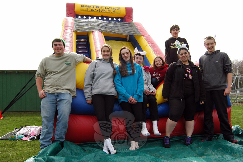 Newtown High School Odyssey of the Mind team members and volunteers gathered together on Friday, April 18, at the start of this year's Bunny Watch, which was conducted April 18 and April 19. From left are Ryan Fitzgerald, Jesse Sailer, Hannah Fitzgerald, Quinn Fitzgerald, Julia Weiland, Nick Weiland, Sydney Chiarito, and Owen Walsh. (Hallabeck photo)
