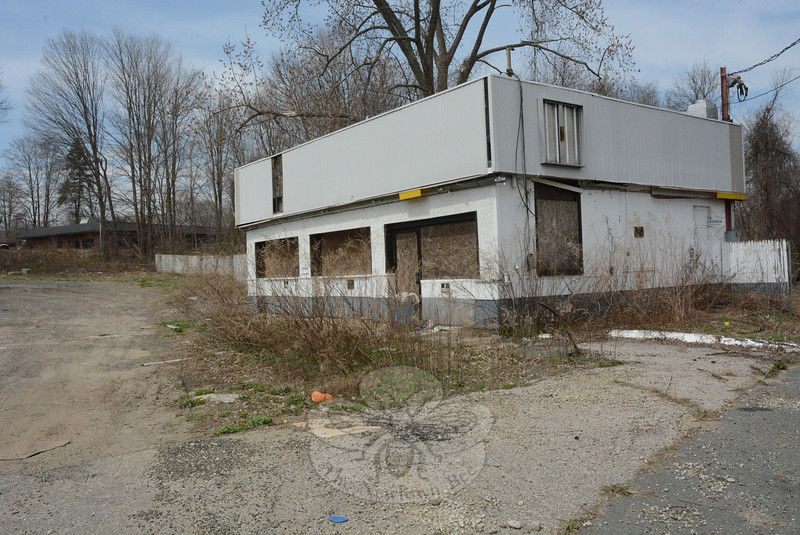 The vacant building which formerly housed a Shell gas station/convenience store at 67 Church Hill Road is slated to be demolished soon to make way for a new gas station/convenience store. Town officials have long considered the deteriorated building an eyesore. (Gorosko photo)