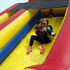 Jessie Sailer went down the inflatable slide with Jack Singewald in her arms during the Bunny Watch on Friday, April 18. (Hallabeck photo)