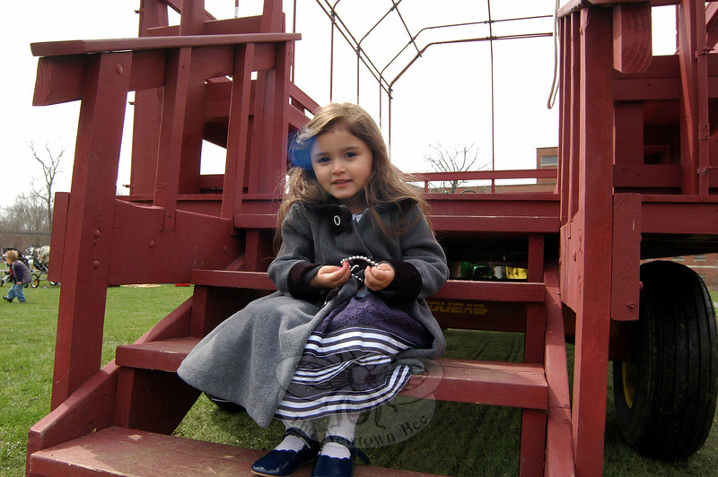 Magdalena Nusbacher sat on one of the wagons at the Bunny Watch on Friday, April 18. (Hallabeck photo)