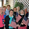 The Newtown Woman's Club, GFWC, hopes residents will purchase American flags to benefit the veterans at Rocky Hill Veterans Home & Hospital and West Haven Veterans Hospital. The flags, each with a ribbon attached naming the honoree, the branch of the military, and the date served or currently serving, can be purchased to honor family members and friends who have served or are serving in the military. The flags will be displayed at the Soldiers and Sailors Monument on Main Street for Memorial Day. Flags cost $5 each and all funds raised will support the veterans. To purchase a flag or for more information call Marion at 203-426-0253, Marilyn at 203-426-6340, or Millie at 203-426-6003, or mail check to PO Box 101, Newtown CT 06470. Members of the Newtown Woman's Club, GFWC flag committee from left are Coke Cramer, Marie Sturdevant, Pat Bailey, Marion Thompson (head of veteran affairs for the club), Millie Anderson, Peg Forbell (club treasurer), Betty Warner, Marilyn Alexander, and Jean Smith.  (Crevier photo)