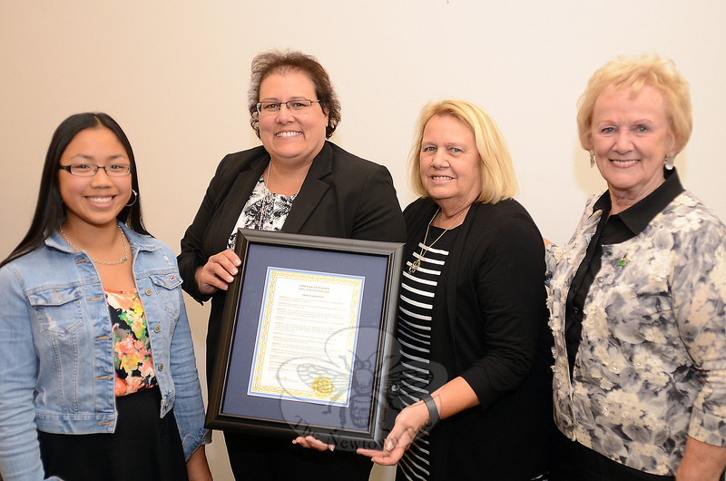 Newtown Recovery Program Leader Anne Alzapiedi, second from left, who was joined by her daughter Katie, left, and her mom, Arlene, was also honored with a municipal proclamation by First Selectman Pat Llodra, right. (Voket photo)