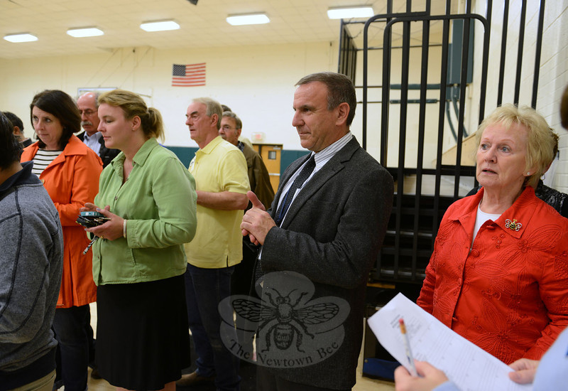New Superintendent of Schools Joseph V. Erardi, Jr, center, stands between First Selectman Pat Llodra, right, and Board of Education Chairman Debbie Leidlein as they and other officials including a handful of Legislative Council members are moments away from learning the budget results shortly after 8 pm Tuesday. (Bobowick photo)