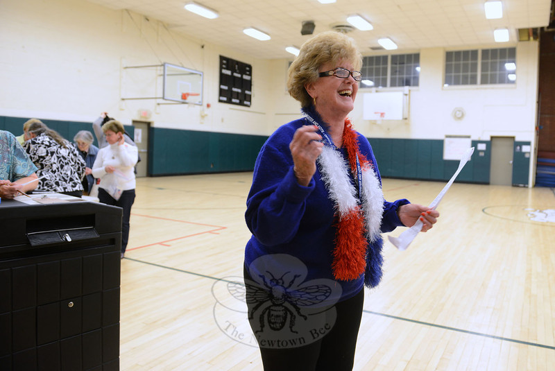 Poll moderator Joanne Albanesi breaks into a wide grin as she reads off what turned out to be a sweeping success as both the municipal and education budgets passed Tuesday night.  (Bobowick photo)