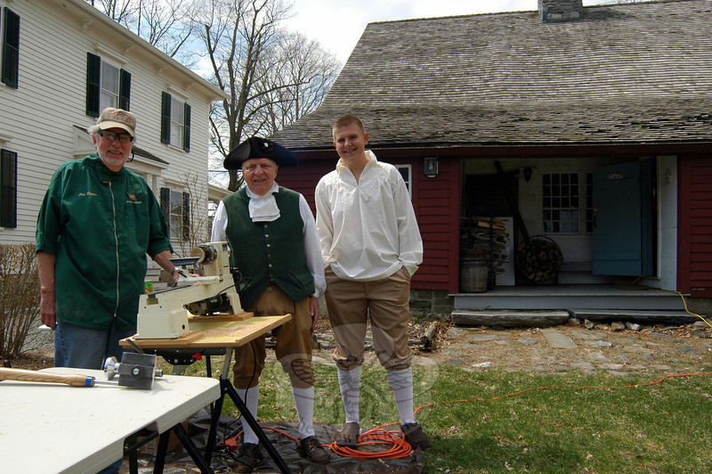 During the Newtown Historical Society's Open House & Living History Demonstration, held at the Matthew Curtiss House on Sunday, April 13, Jim Degen, left, offered a free woodturning demonstration. Standing with Mr Degen are Mike Asselta, center, and Erik Benson. (Hallabeck photo)
