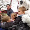 From left, Sawyer, Autumn, and Noah Beninati hugged the bunny at this year's Bunny Watch. (Hallabeck photo)