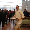 "A substitute teacher at Newtown High School with an interest in the culinary arts, Ryan Eberts assisted students during ""A Community Table: Food from the Heart, Nourishing the Soul"" at NHS on March 27. (Hicks photo)"