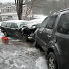 During a spring snowstorm at about 7:38 am on March 31, a two-vehicle head-on collision occurred near 4 Bennetts Bridge Road in Sandy Hook, just north of Berkshire Road, police said. Motorist James O'Connell, Jr, 46, of 7 Kale Davis Road was driving a 1997 Volvo 850 station wagon southwestward on Bennetts Bridge Road, as motorist Michelina DiSibio, 44, of 25 Charter Ridge Drive was driving a 2011 Honda Pilot SUV northeastward there, police said. The Volvo went out of control on the snowy road, crossed into the opposite lane and then collided head-on with the Honda. Newtown Volunteer Ambulance Corps members and Sandy Hook volunteer firefighters responded to the accident. Police said that DiSibio and Volvo passenger Terri Fernand, 46, of 7 Kale Davis Road received injuries in the crash. Police said they issued O'Connell a misdemeanor summons for failure to keep to the right on a curve, failure to have automotive insurance, misuse of marker plates, and driving an unregistered vehicle. O'Connell was released on a written promise to appear in court on April 15, police said.  (Hicks photo)
