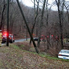 Motorist Valentina Gallo, 16, of 28 Old Green Road was driving a 1993 Toyota Corolla sedan eastward on Schoolhouse Hill Road, just west of its intersection with Evergreen Road, at about 4:52 pm on March 30, when the auto went off the right side of the road, rolled down a slope and entered some brush. There were no injuries, police said. Sandy Hook firefighters responded to the scene. Police said they issued Gallo a written warning for traveling too fast for conditions and for making a restricted turn.  (Hicks photo)