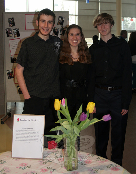 "A special event at Newtown High School last week highlighted the ongoing collaboration between the Newtown High School Culinary Department and the student-launched organization Feeding The Need. Representing Feeding The Need during ""A Community Table: Food from the Heart, Nourishing the Soul"" were, from left, Trystan Wagner, FTN Founder Sonya Stanczyk, and Thomas Stanczyk. (Hicks photo)"