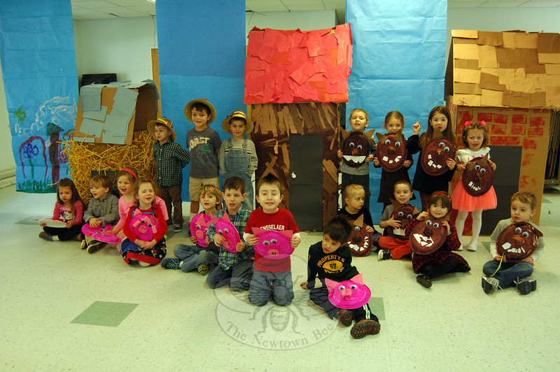 "Instead of ""Three Little Pigs"" there were eight little pigs, one ""Mama Pig,"" eight wolves, and three farmers in Wesley Learning Center's version of the story, performed for parents and siblings at the preschool on Thursday, March 27. Wesley Learning Center Director Rahna Peck narrated the skit while the students performed their parts. Before the play began the students lined up with their theatrical garb for a photo. (Hallabeck photo)"