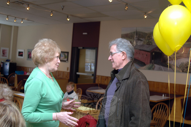 Carol Mattegat speaks with Bob Llodra Thursday, March 27, as he and other guests gathered at LeReine's Cuisine that afternoon. Friends came to celebrate with George and Carol Mattegat as they prepare to move out of town in late March to Florida after decades of service in the Newtown community. Mr Mattegat had been a past Lions Club president, bus driver, animal control officer, volunteer firefighter, Labor Day parade organizer, and more. Ms Mattegat had served in the Registrar of Voters office, on the Police Commission, the Republican Town Committee, and with local women's clubs, to name a few. (Bobowick photo)