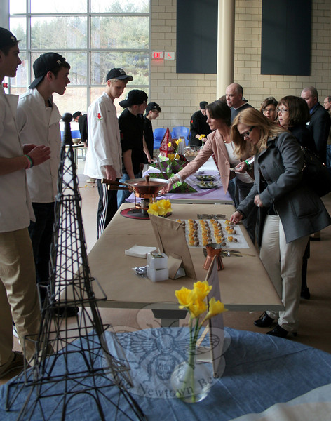 "Guests were invited to try appetizers, entrees, desserts and beverages presented by NHS Culinary Arts students during ""A Community Table: Food from the Heart, Nourishing the Soul"" at Newtown High School on March 27. (Hicks photo)"