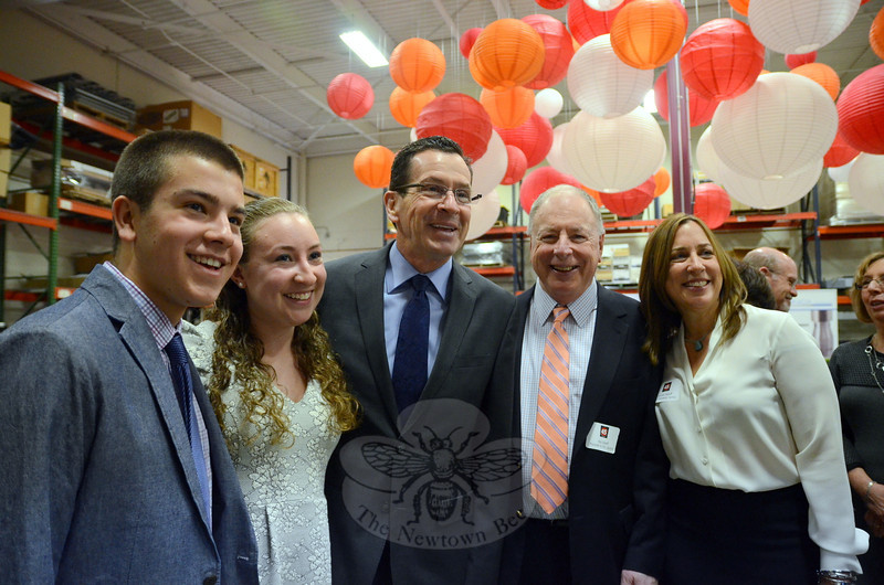Governor Dannel P. Malloy was among the guests celebrating the 45th Anniversary of Newtown-based Sonics & Materials, and the 75th birthday of company founder, President and CEO Robert Soloff. The governor was welcomed by Mr Soloff's grandchildren Hannah and Benjamin Malowitz, and his daughter, company Executive VP Lauren Soloff. (Voket photo)