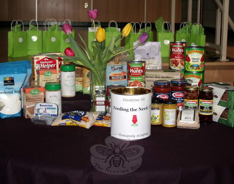 "Donations for Feeding The Need (FTN) were received during ""A Community Table: Food from the Heart, Nourishing the Soul"" at Newtown High School on March 27. The group received approximately $660, which will benefit the program and the Connecticut Food Bank, according to FTN Founder Sonya Stanczyk. (Hicks photo)"