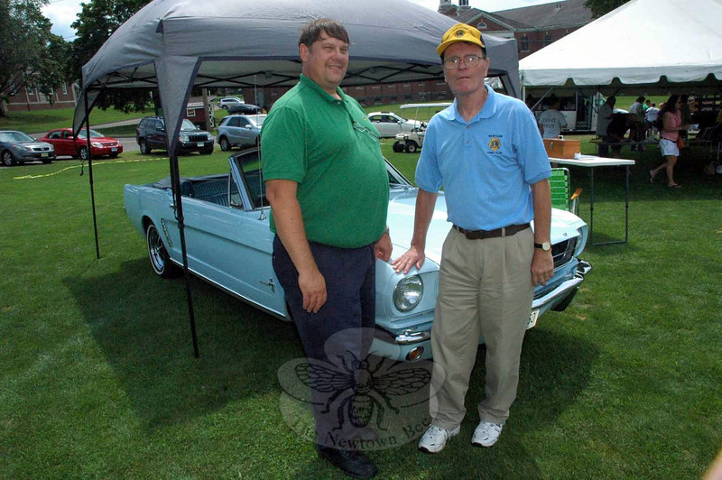 Two members of the Newtown Lions Club sold raffle tickets for the group's annual drawing for a Ford Mustang convertible. Shown are Jim Manville, left, and Stan Wyslick at The Great Newtown Reunion event held on Saturday, July 27. (Gorosko photo)