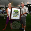 Christine and Kevin Yacko display the painting Mr Yacko won at silent auction at The Great New-town Reunion event held on Saturday, July 27. (Bobowick photo)